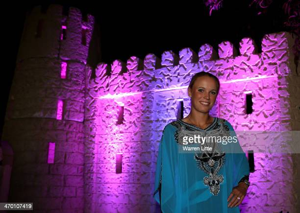 Caroline Wozniacki of Denmark poses for a picture in traditional dress and with a falcon during the players party during day two of the WTA Dubai...