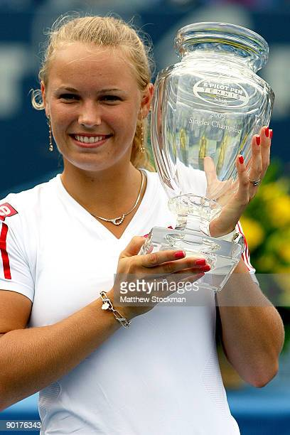 Caroline Wozniacki of Denmark poses for photographers after defeating Elena Vesnina of Russia during the final of the Pilot Pen Tennis tournament at...