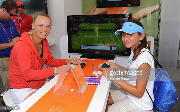 Caroline Wozniacki of Denmark poses with fans during day 5 of the Sony Ericsson Open at Crandon Park Tennis Center on March 23 2012 in Key Biscayne...