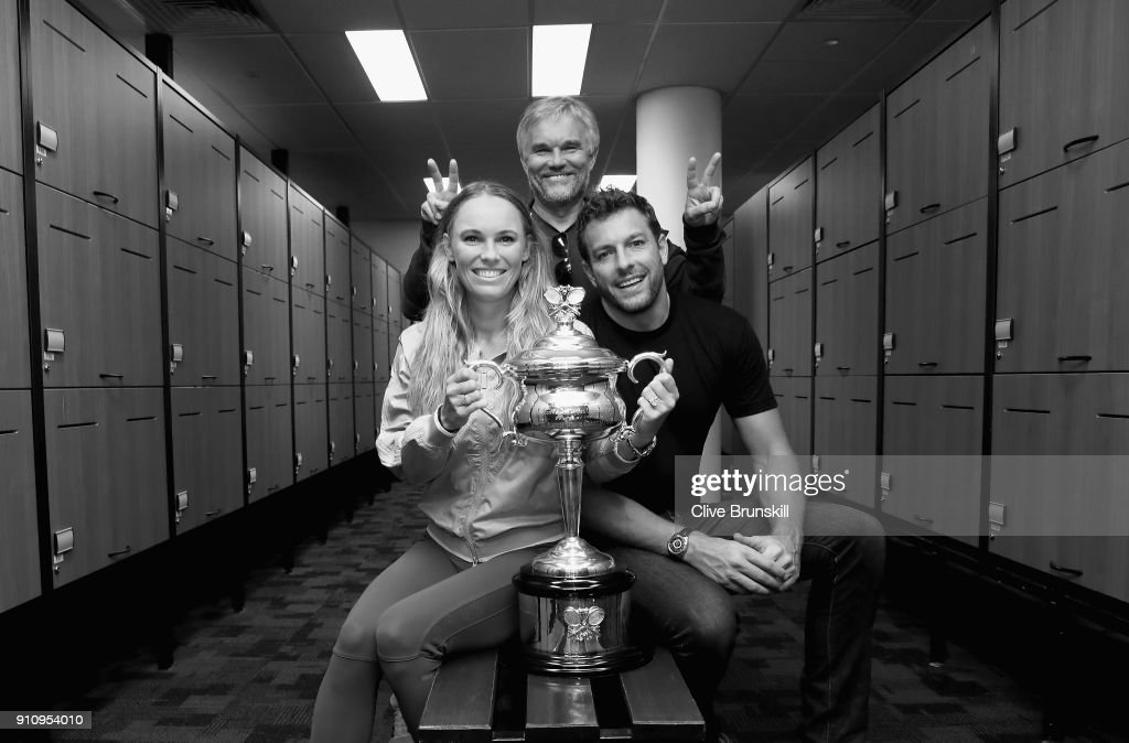Caroline Wozniacki of Denmark poses with fiance David Lee and father Piotr with the Daphne Akhurst Trophy in the locker room after winning the Women's Singles Final against Simona Halep of Romania on day 13 of the 2018 Australian Open at Melbourne Park on January 27, 2018 in Melbourne, Australia.