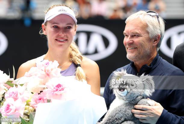 Caroline Wozniacki of Denmark poses with her father and coach Piotr Wozniacki after her Women's Singles third round match against Ons Jabeur of...
