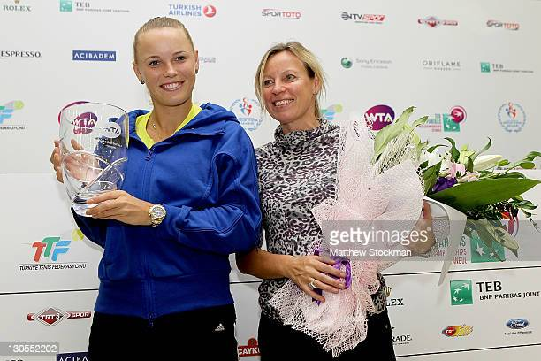 Caroline Wozniacki of Denmark poses with her mother Anna Wozniack after seccuring the year end number WTA ranking during the TEB BNP Paribas WTA...