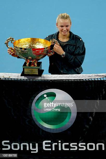 Caroline Wozniacki of Denmark poses with her trophy after the winning the Women's Singles final against Vera Zvonareva of Russia on day eleven of the...