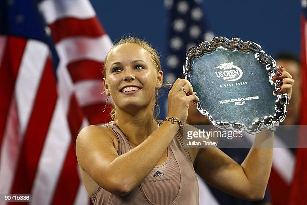 Caroline Wozniacki of Denmark poses with her trophy after the Women�s Singles final against Kim Clijsters of Belgium on day fourteen of the 2009 US...