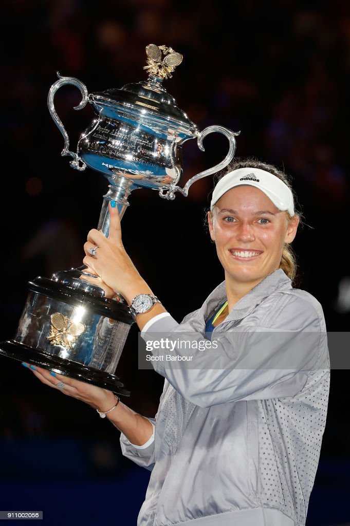 Caroline Wozniacki of Denmark poses with the Daphne Akhurst Memorial Cup after winning the women's singles final against Simona Halep of Romania on day 13 of the 2018 Australian Open at Melbourne Park on January 27, 2018 in Melbourne, Australia.