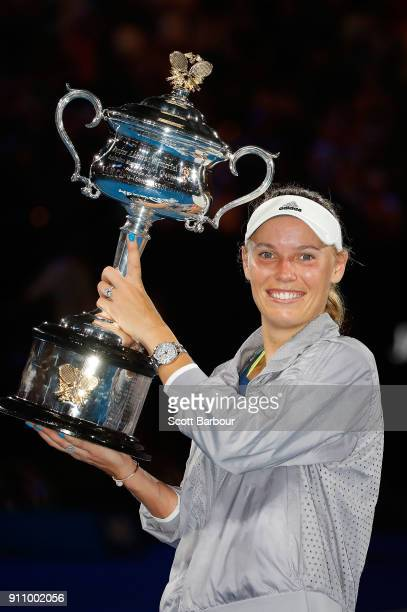 Caroline Wozniacki of Denmark poses with the Daphne Akhurst Memorial Cup after winning the women's singles final against Simona Halep of Romania on...