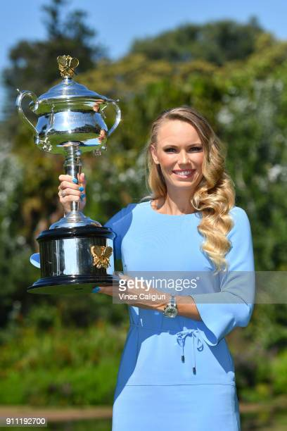 Caroline Wozniacki of Denmark poses with the Daphne Akhurst Memorial Cup in the Royal Botanical Gardens after winning the 2018 Women's Singles...