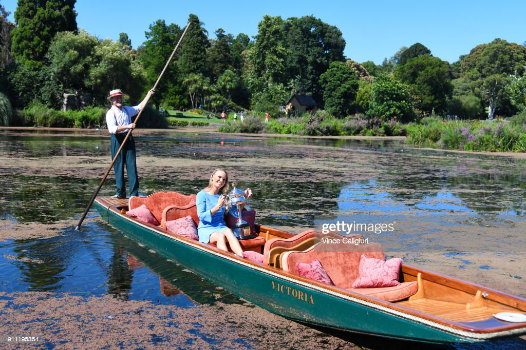 Caroline Wozniacki of Denmark poses with the Daphne Akhurst Memorial Cup on an elegant wooden punt ride at the Royal Botanic Gardens after winning the 2018 Women's Singles Australian Open Championship on January 28, 2018 in Melbourne, Australia.