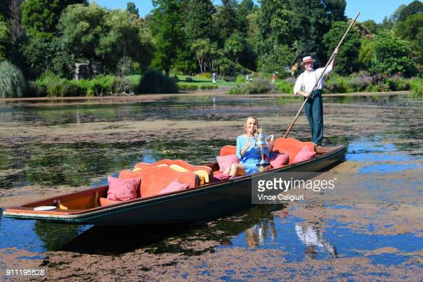 Caroline Wozniacki of Denmark poses with the Daphne Akhurst Memorial Cup on an elegant wooden punt ride at the Royal Botanic Gardens after winning...