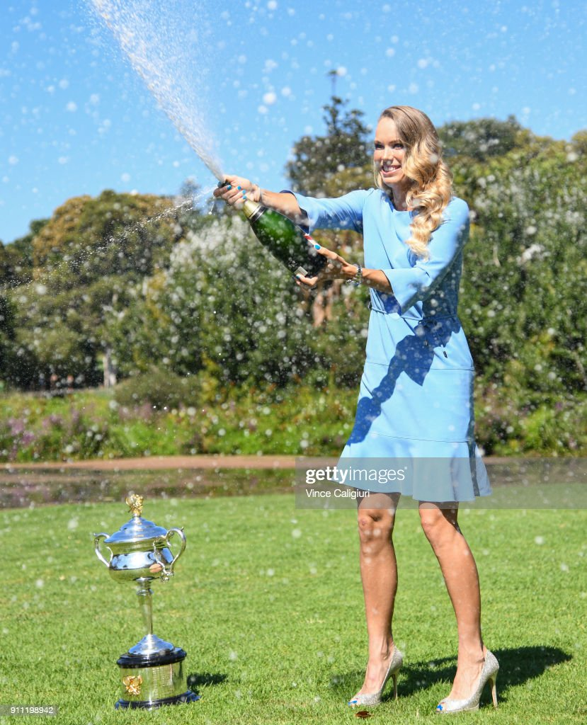 Caroline Wozniacki of Denmark poses with the Daphne Akhurst Memorial Cup and celebrates by spraying champagne in the Royal Botanical Gardens after winning the 2018 Women's Singles Australian Open Championship on January 28, 2018 in Melbourne, Australia.