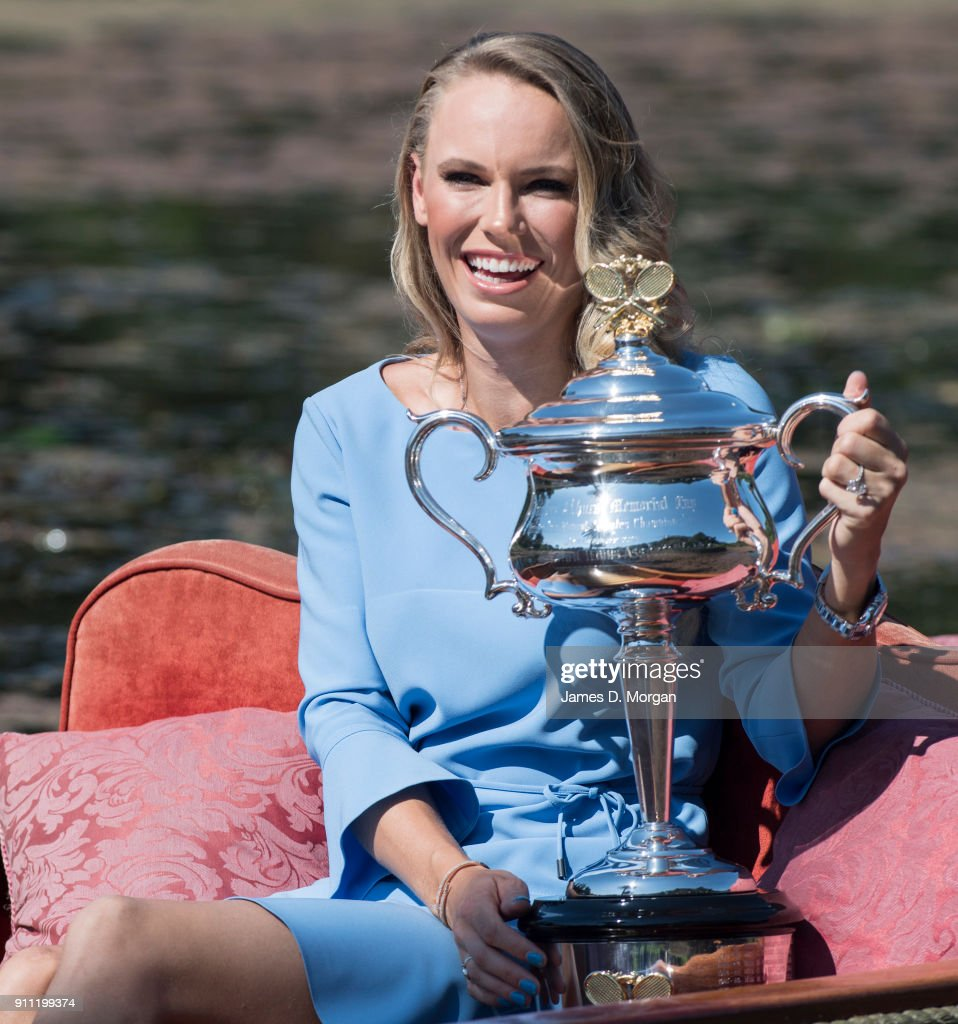 Caroline Wozniacki of Denmark poses with the Daphne Akhurst Memorial Cup on a punt whilst taking a ride on Ornamental Lake in the Royal Botanical Gardens after winning the 2018 Women's Singles Australian Open Championship on January 28, 2018 in Melbourne, Australia.