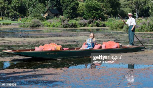 Caroline Wozniacki of Denmark poses with the Daphne Akhurst Memorial Cup on a punt whilst taking a ride on Ornamental Lake in the Royal Botanical...