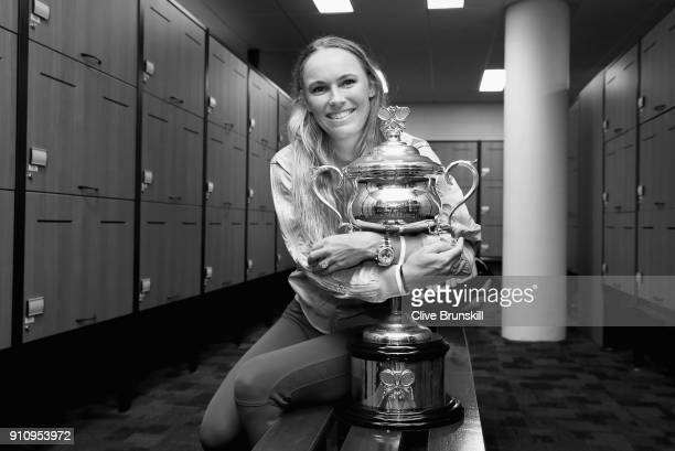 Caroline Wozniacki of Denmark poses with the Daphne Akhurst Trophy in the changerooms after winning the Women's Singles Final against Simona Halep of...