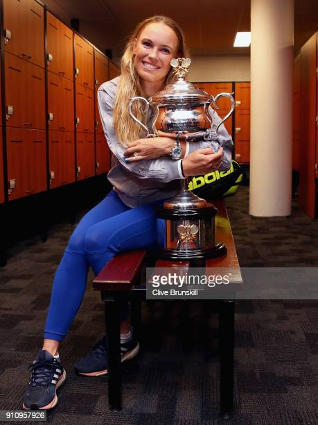 Caroline Wozniacki of Denmark poses with the Daphne Akhurst Trophy in the change-rooms after winning the Women's Singles Final against Simona Halep...