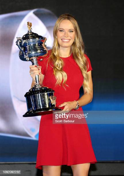 Caroline Wozniacki of Denmark poses with the the Daphne Akhurst Memorial Cup during the Official Draw ahead of the 2019 Australian Open at Margaret...