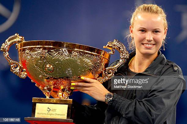 Caroline Wozniacki of Denmark poses with the trophy after defeating Vera Zvonareva of Russia in the Women's Singles final on day eleven of the 2010...