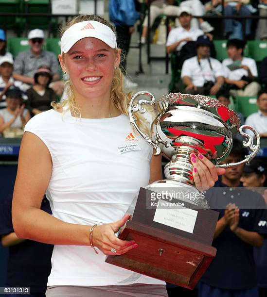 Caroline Wozniacki of Denmark poses with the trophy after the win over Kaia Kanepi of Estonia in the womens singles final on day seven of the AIG...