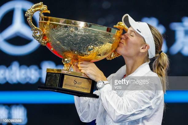 Caroline Wozniacki of Denmark poses with the trophy after winning the Women's Singles final match against Anastasija Sevastova of Latvia on day nine...