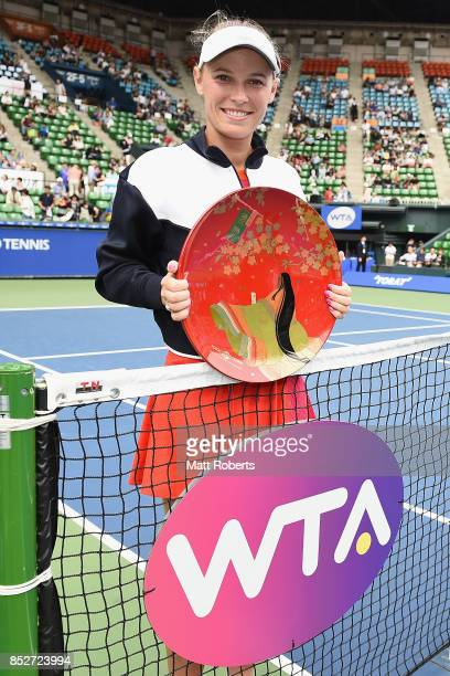 Caroline Wozniacki of Denmark poses with the winners trophy after defeating Anastasia Pavlyuchenkova of Russia in the women's singles final match on...