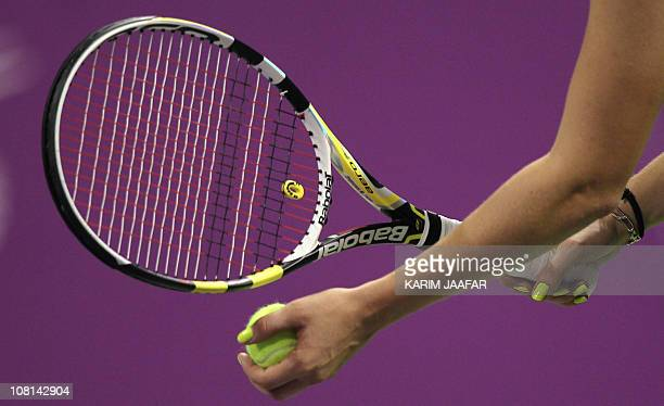 Caroline Wozniacki of Denmark prepares to serve to Kim Clijsters of Belgium during the WTA Championships final tennis match at the Khalifa...