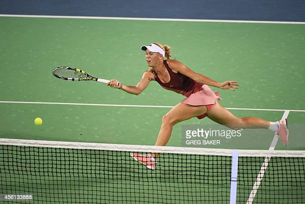 Caroline Wozniacki of Denmark reaches for a return during her semifinal match against Canada's Eugenie Bouchard at the Wuhan Open tennis tournament...