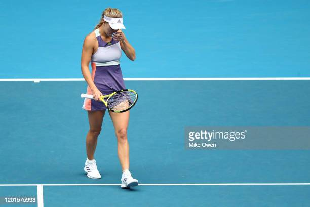 Caroline Wozniacki of Denmark reacts after losing her Women's Singles third round match against Ons Jabeur of Tunisia on day five of the 2020...