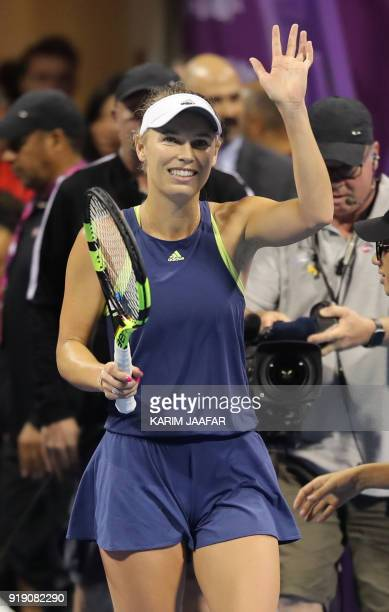 Caroline Wozniacki of Denmark reacts after winning against Angelique Kerber of Germany during their singles match in the quarterfinal round of the...