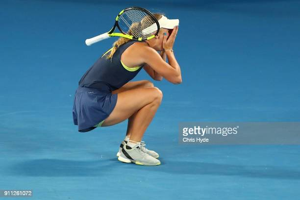 Caroline Wozniacki of Denmark reacts after winning championship point in her women's singles final against Simona Halep of Romania on day 13 of the...