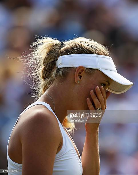 Caroline Wozniacki of Denmark reacts in her Ladies' Singles Fourth Round match against Garbine Muguruza of Spain during day seven of the Wimbledon...
