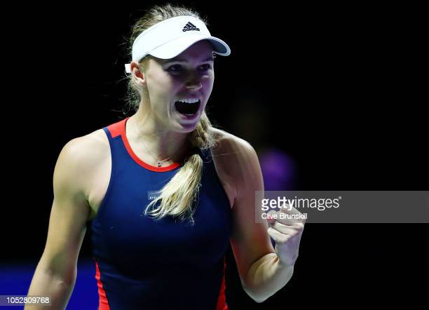 Caroline Wozniacki of Denmark reacts to match point in her singles match with Petra Kvitova of the Czech Republic prior to their singles match during...