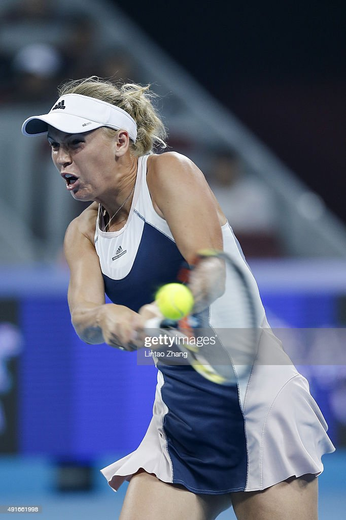 Caroline Wozniacki of Denmark returns a shot against Angelique Kerber of Germany during the Women's singles Second round match on day five of the 2015 China Open at the China National Tennis Centre on October 6, 2015 in Beijing, China.