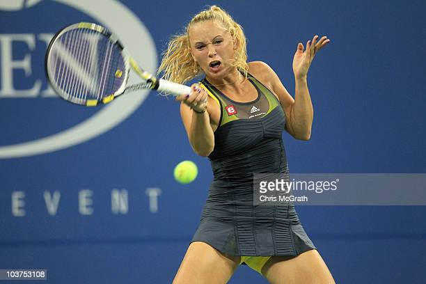 Caroline Wozniacki of Denmark returns a shot against Chelsey Gullickson of the United States during her first round women's singles match on day two...