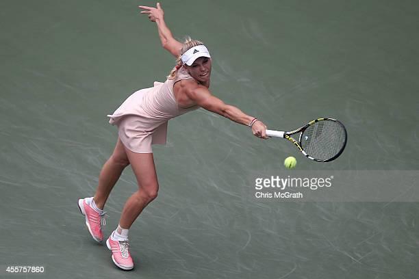 Caroline Wozniacki of Denmark returns a shot against Garbine Muguruza of Spain during their women's singles semi-final match on day six of the Toray...