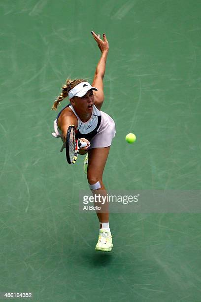 Caroline Wozniacki of Denmark returns a shot against Jamie Loeb of the United States during their Women's Singles First Round match on Day Two of the...
