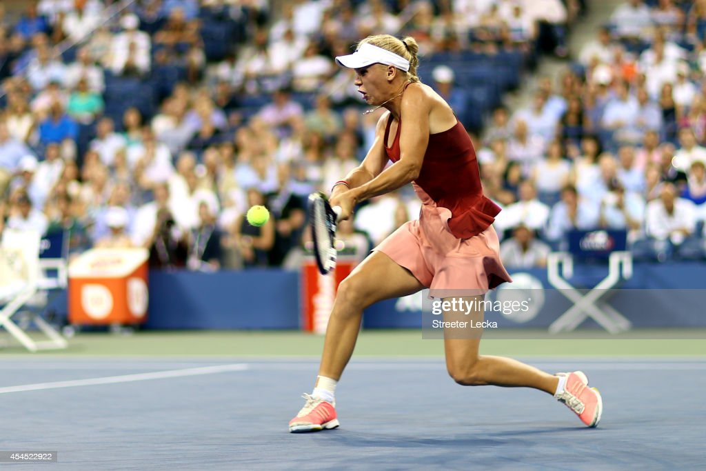 Caroline Wozniacki of Denmark returns a shot against Sara Errani of Italy during their women's singles quarterfinal on Day Nine of the 2014 US Open at the USTA Billie Jean King National Tennis Center on September 2, 2014 in the Flushing neighborhood of the Queens borough of New York City.