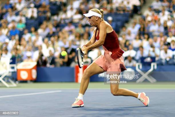 Caroline Wozniacki of Denmark returns a shot against Sara Errani of Italy during their women's singles quarterfinal on Day Nine of the 2014 US Open...