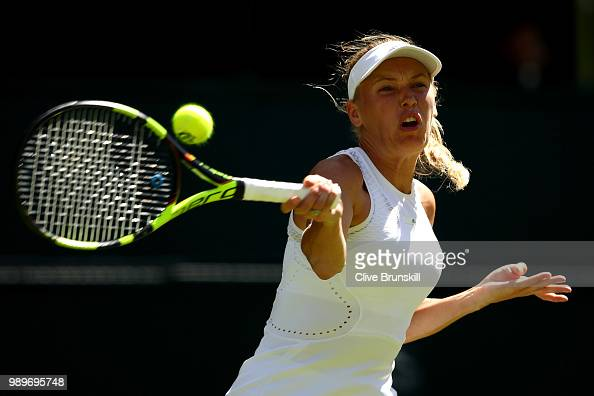 Caroline Wozniacki of Denmark returns a shot against Varvara Lepchenko of the United States during their Ladies' Singles first round match on day one...