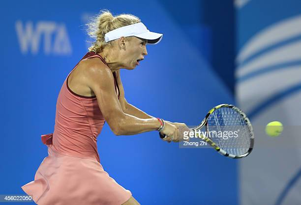 Caroline Wozniacki of Denmark returns a shot during her match against Casey Dellacqua of Australia on day four of 2014 Dongfeng Motor Wuhan Open at...