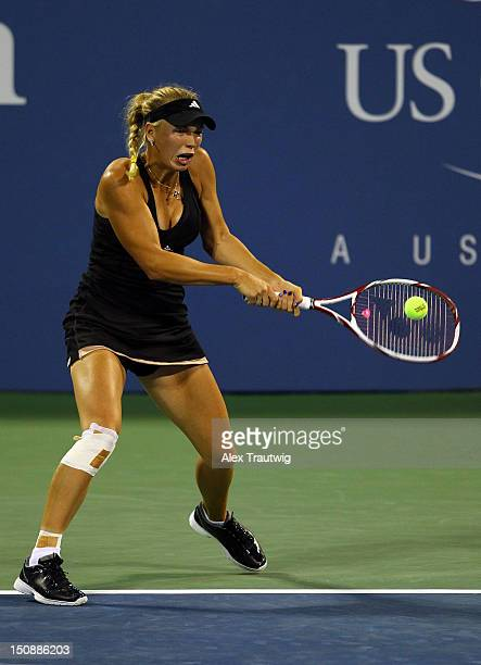 Caroline Wozniacki of Denmark returns a shot during her women's singles first round match against IrinaCamelia Begu of Romania on Day Two of the 2012...