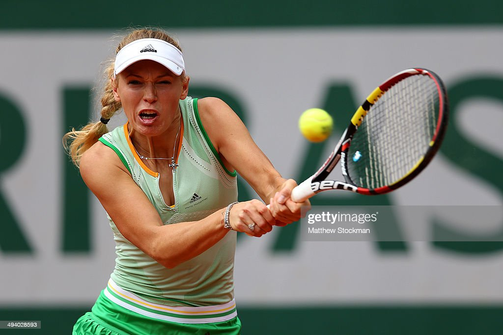 Caroline Wozniacki of Denmark returns a shot during her women's singles match against Yanina Wickmayer of Belgium on day three of the French Open at Roland Garros on May 27, 2014 in Paris, France.
