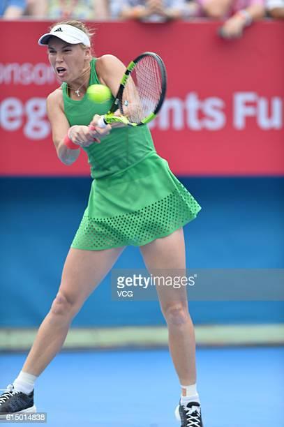 Caroline Wozniacki of Denmark returns a shot during the Women's single final match against Kristina Mladenovic of France on day seven of the...