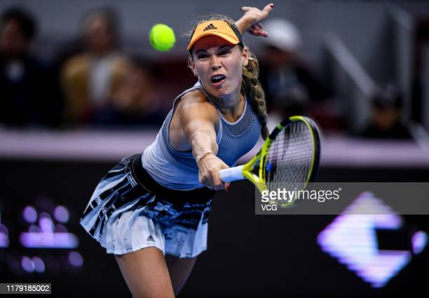 Caroline Wozniacki of Denmark returns a shot in the Women's Singles semifinal match against Naomi Osaka of Japan on Day eight of 2019 China Open at...