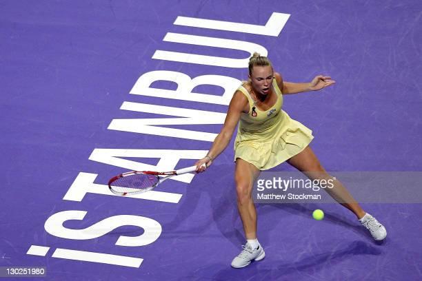 Caroline Wozniacki of Denmark returns a shot to Agnieszka Radwanska of Poland during round robin play of the TEB BMP Paribas WTA Championships...