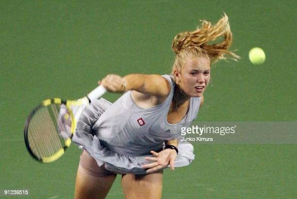Caroline Wozniacki of Denmark returns a shot to Aleksandra Wozniak of Canada during day three of the Toray Pan Pacific Open Tennis tournament at...