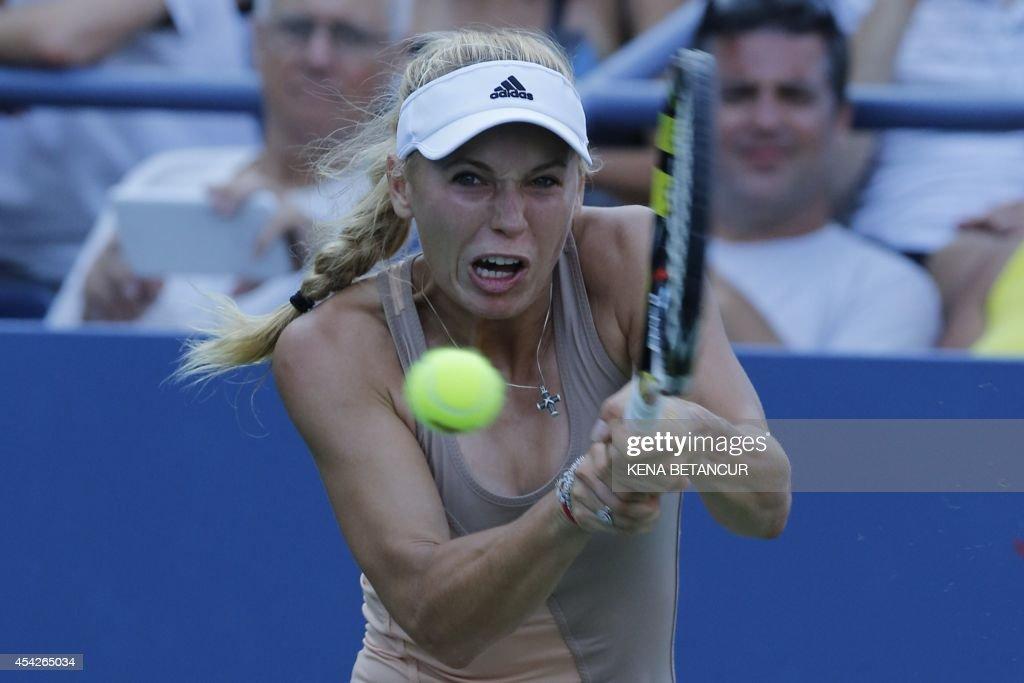 Caroline Wozniacki of Denmark returns a shot to Aliaksandra Sasnovich of Belarus during the 2014 US Open women's singles match at the USTA Billie Jean King National Tennis Center August 27, 2014 in New York.AFP PHOTO/Kena Betancur