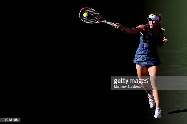 Caroline Wozniacki of Denmark returns a shot to Alisa Kleybanova of Russia during the BNP Paribas Open at the Indian Wells Tennis Garden on March 15...