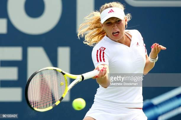 Caroline Wozniacki of Denmark returns a shot to Anastasia Pavlyuchenkova of Russia during the Pilot Pen Tennis tournament at the Connecticut Tennis...