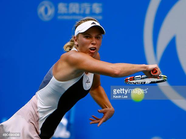 Caroline Wozniacki of Denmark returns a shot to Anna Karolina Schmiedlova of Slovakia in her match in day 3 of 2015 Dongfeng Motor Wuhan Open at...