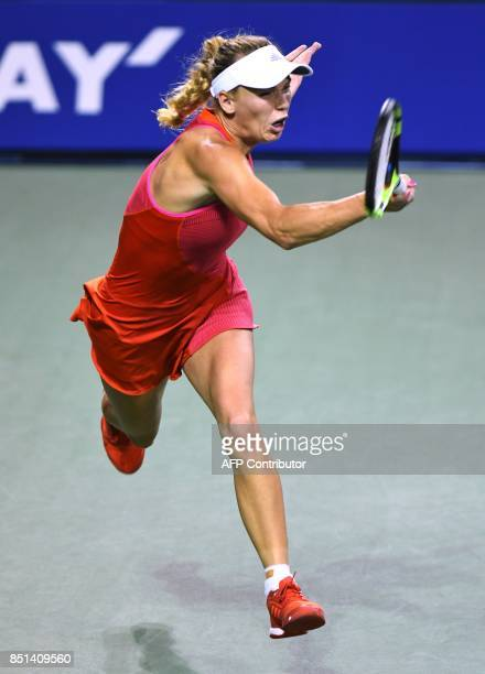 Caroline Wozniacki of Denmark returns a shot to Dominika Cibulkova of Slovakia during their women's singles quarterfinal match at the Pan Pacific...