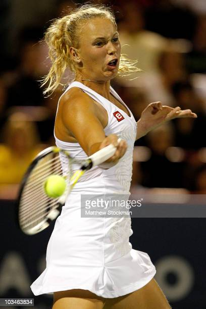 Caroline Wozniacki of Denmark returns a shot to Flavia Pennetta of Italy during the Rogers Cup at Stade Uniprix on August 19 2010 in Montreal Canada